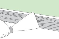 Удаление подтеков клея шпателем